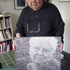 William H. Gass holding artwork by Buzz Spector