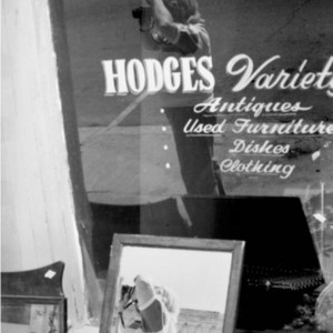 Reflection of William H. Gass taking photographs, Iowa 1989