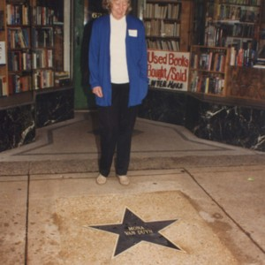 Mona Van Duyn posing in from of her St. Louis Walk of Fame star on the Delmar Loop
