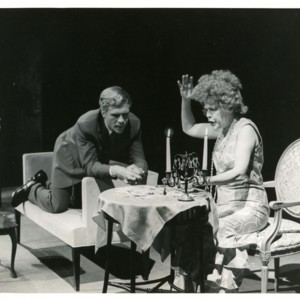 Tom Ligon and Eleanor Wilson on stage during a performance of <em>The Straw Market</em>
