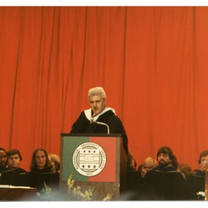 Howard Nemerov speaking at a Washington University graduation