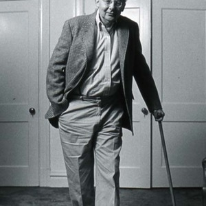Stanley Elkin leaning on his cane